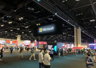 Photograph taken at a conference, with a Microsoft banner hanging from the ceiling