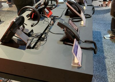 Picture of a few telephones on display at a conference